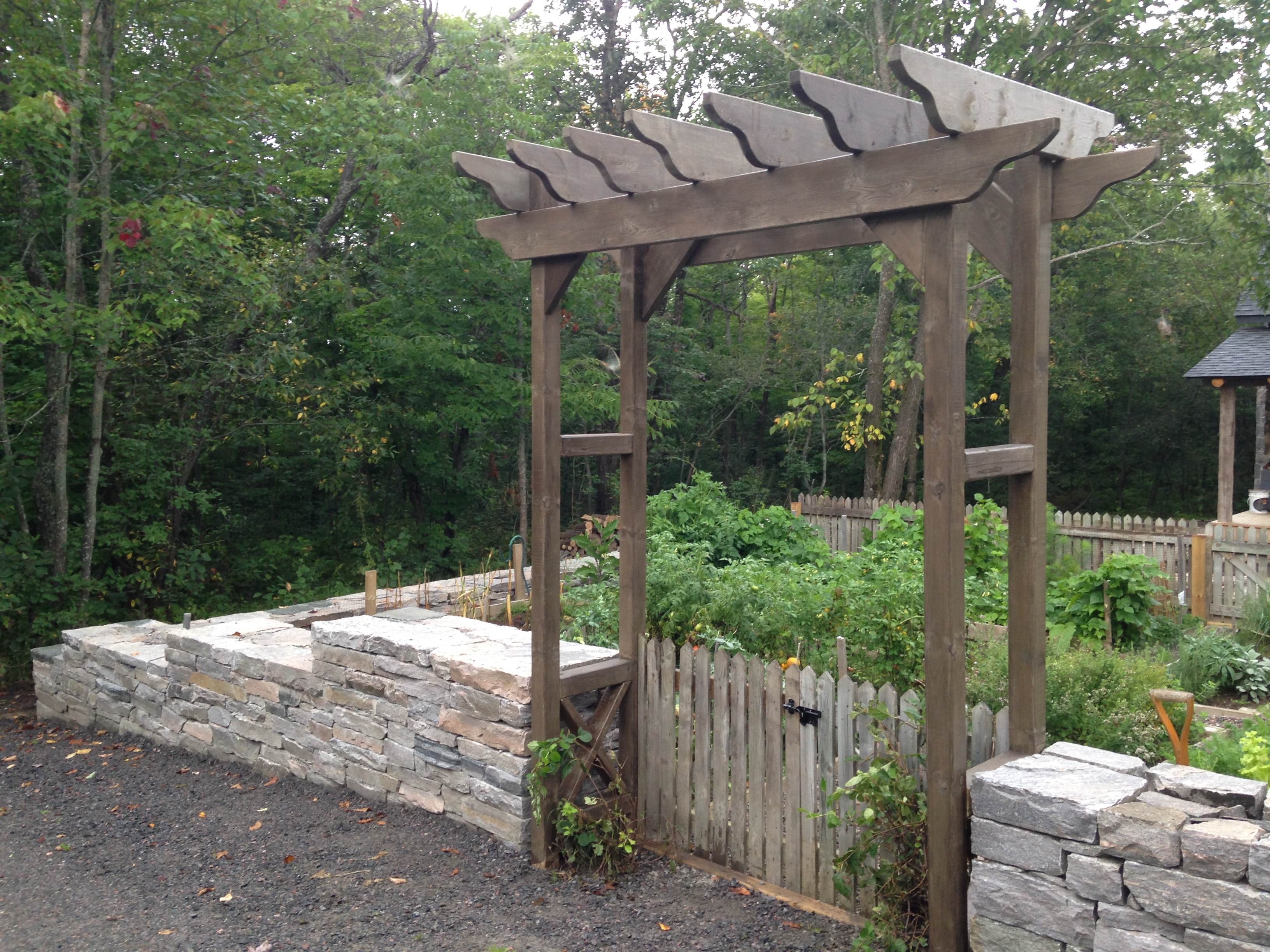 Dry stack retaining wall and trellis