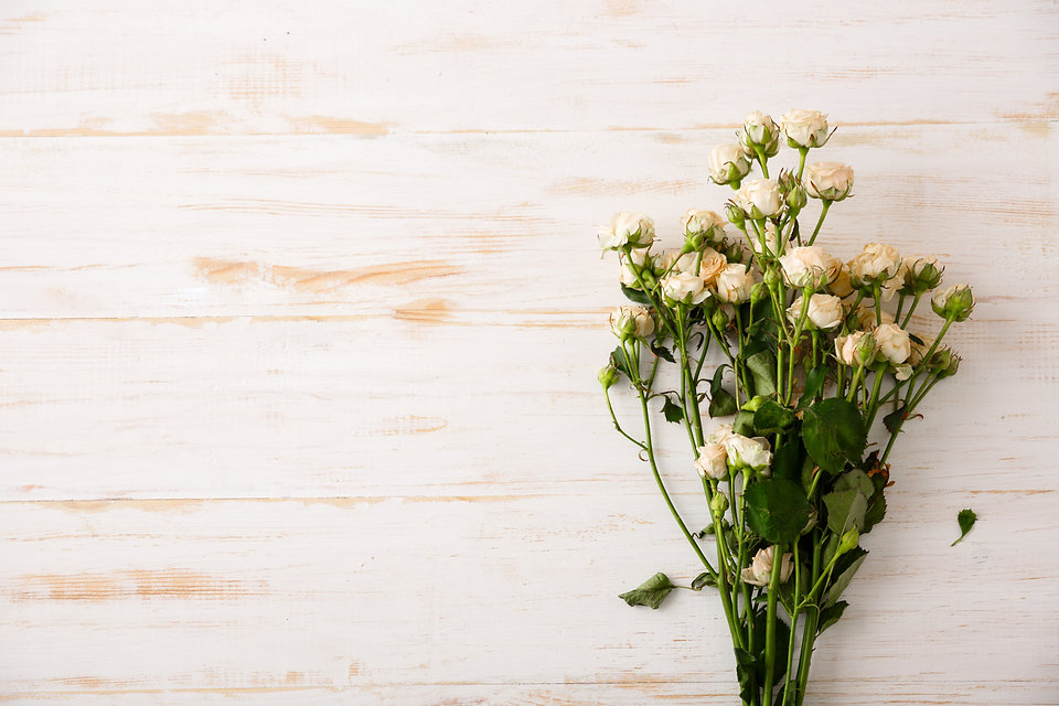 beautiful-white-roses-wooden-table.jpg