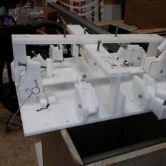 Custom holding device for making kiosk
