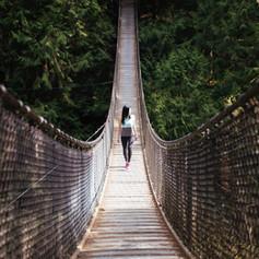 woman-walks-bridge_4460x4460.jpg