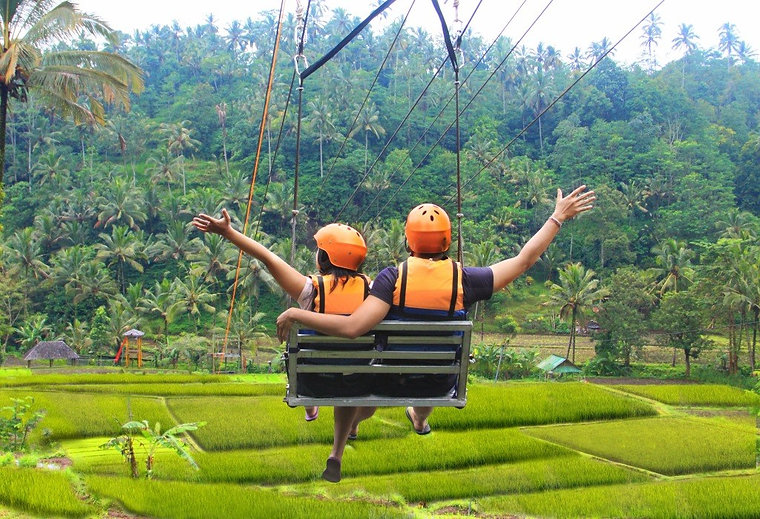 Couple on a zip line lift in the rainforest