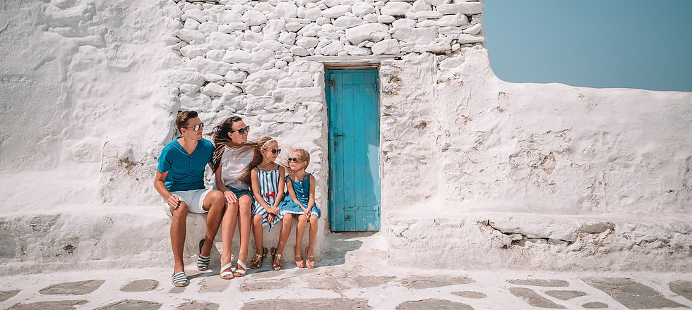 Young family exploring a Greek Isle town