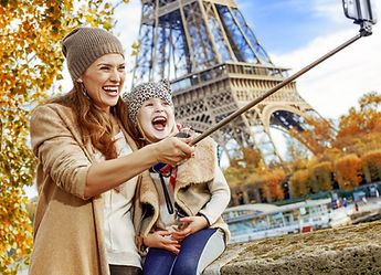 Mother and daughter take a selfie at the Eiffel Tower in Paris