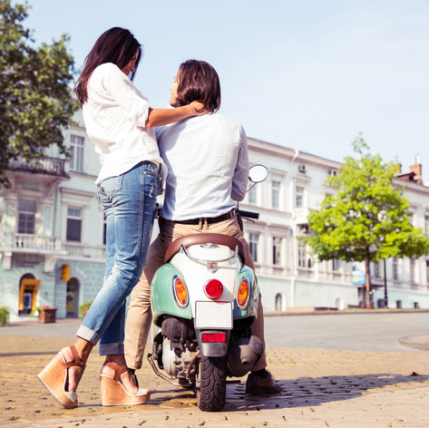 portrait-of-happy-young-couple-on-scoote