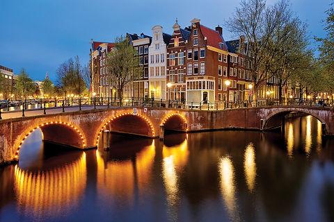 Bridges lit up in Amsterdam at night