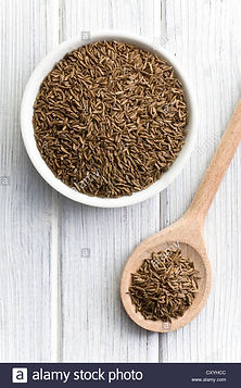 the-cumin-seeds-in-wooden-spoon-CXYHCC.j