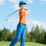 Boy playing golf in summer.jpg