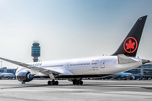 ac_787_with_yvr_tower_wide.jpg