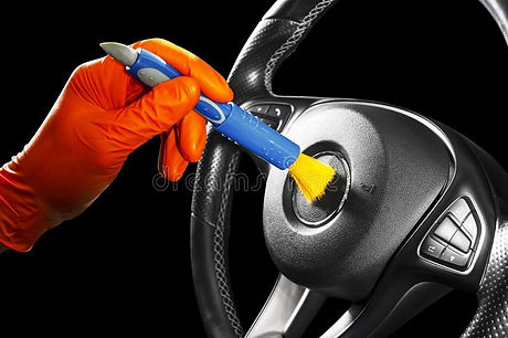 man-cleaning-car-steering-wheel-brush-ca