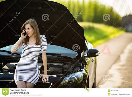 pretty-young-woman-calling-roadside-serv
