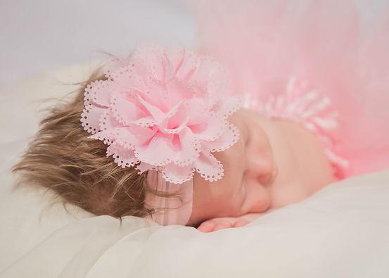 Lauren-B-3-months-sleeping-on-bed-close-