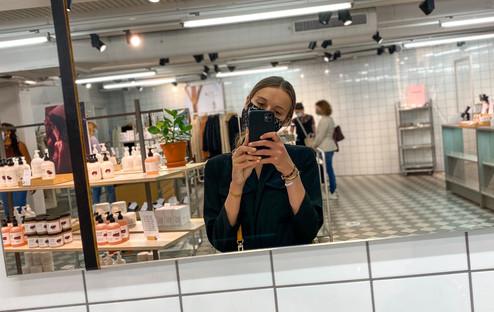 A girl taking a selfie in a mirror