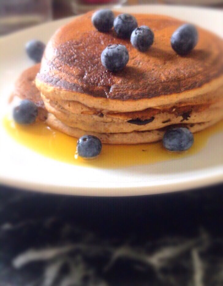 Frontal view of cinnamon pancakes tower for healthy breakfast