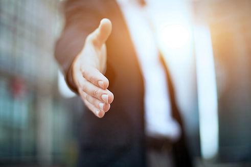 An hand offering a handshake