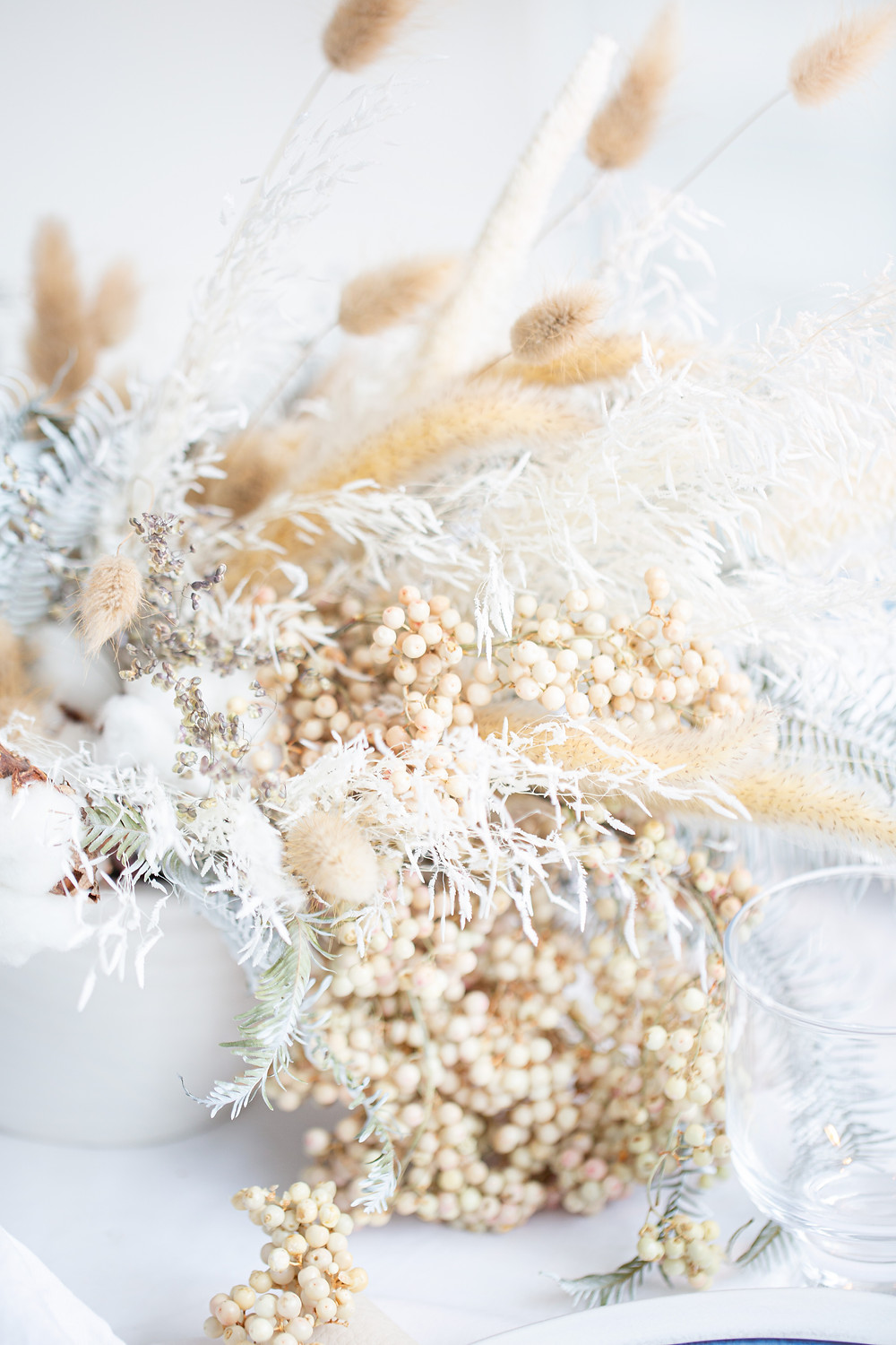 natural centerpiece created with dried bunny tails, pepper berries, cotton  and wintery dried products