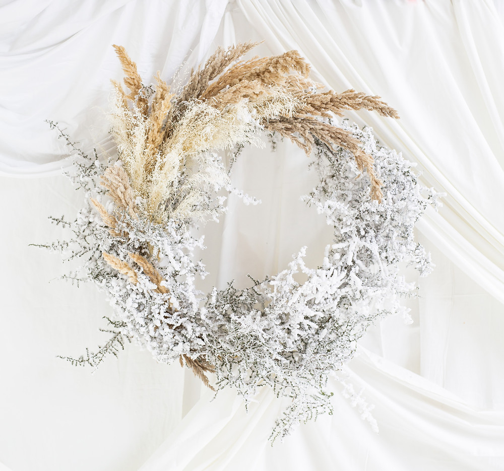 winter wreath with pampas grass and faux snow covered asparagus ferns