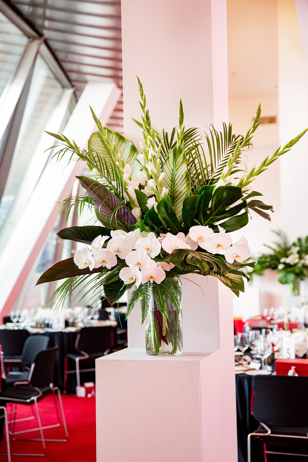 large floral arrangement with white flowers such as orchids and gladiolas