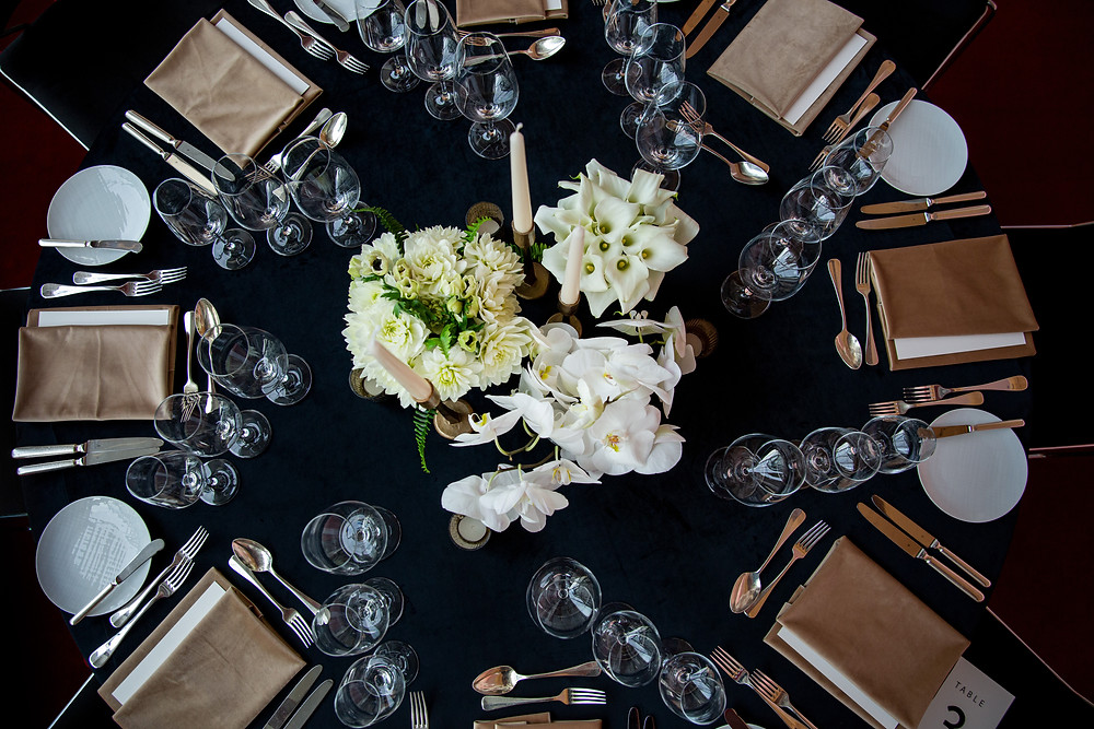 corporate dinner setting in black, white and gold