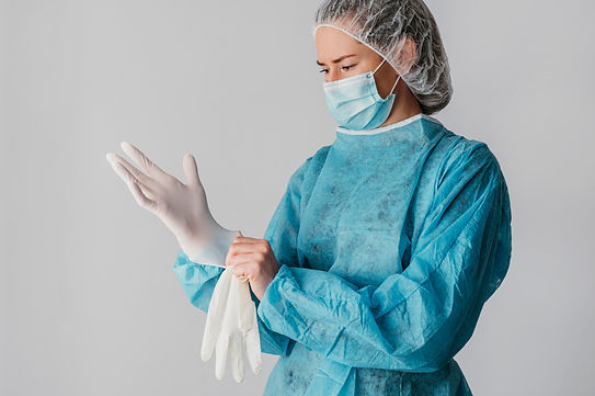 doctor-putting-surgical-gloves.jpg