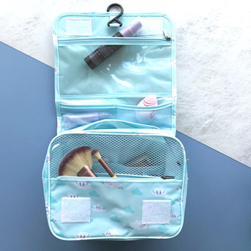 Using her blue stationery bag with pens and pencils in it