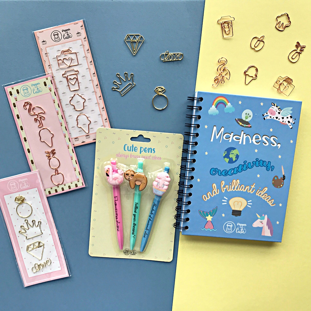 Stationery set with notebook, pens and paper clips