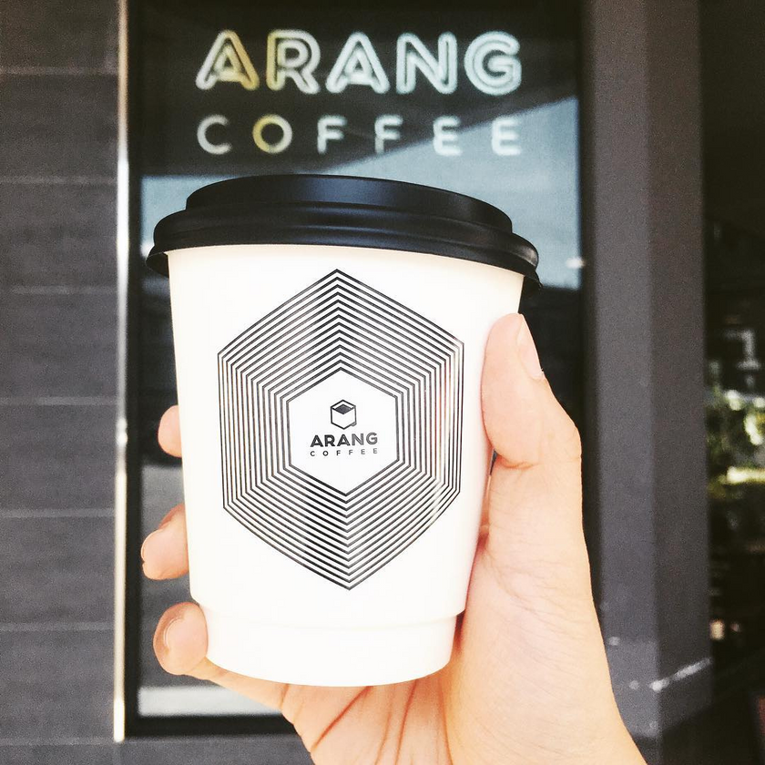Hot Latte in paper cup at Arang Coffee