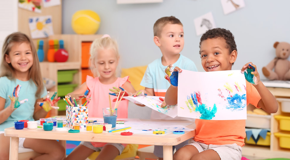 Cute children painting with their palms