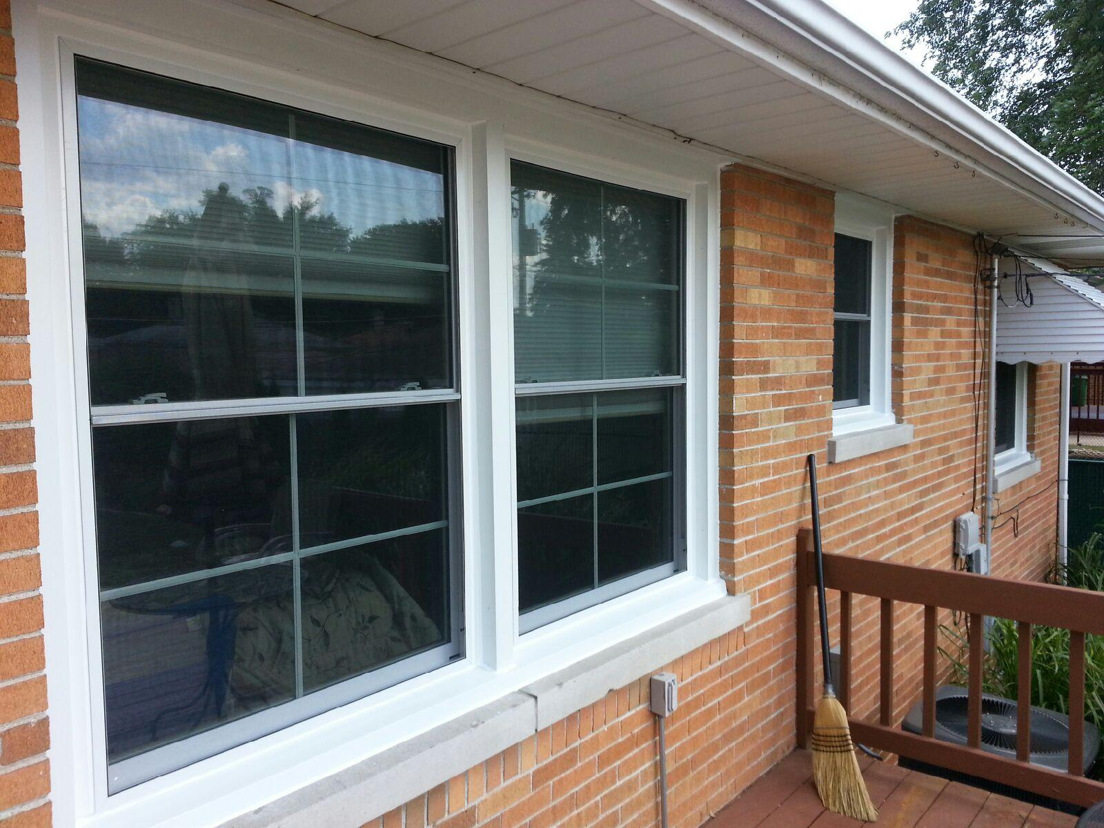 Double hung windows with grids.
