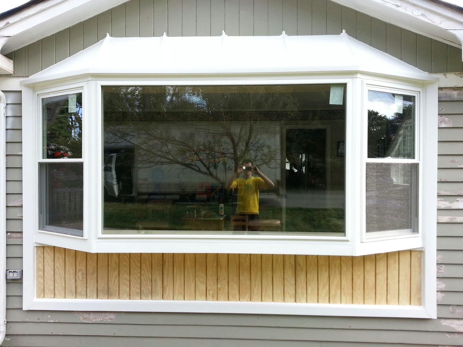 Double hung bay window with hip roof
