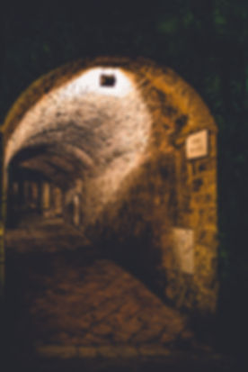 A street in Volterra, Italy that looks like a tunnel.