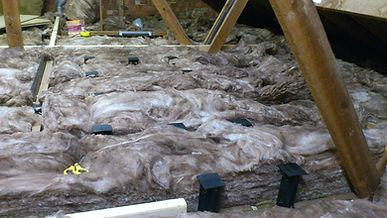 Loft insulation in position around Loft Legs