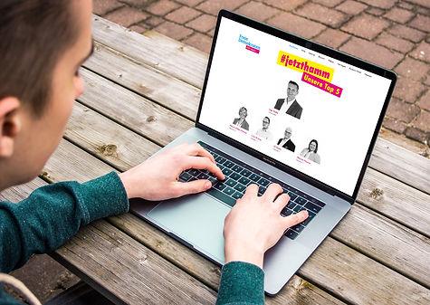 Man Typing on MacBook Pro Mockup Free.jp