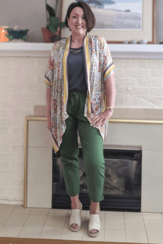 Moss green linen pants with a floral kimono cover up to wear to work.