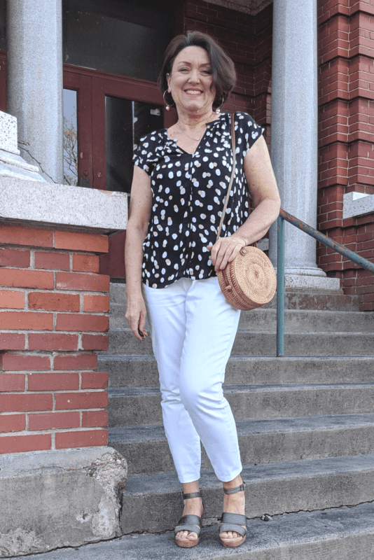 Wear your white jeans with a cute black and white polka dot shirt this summer. Add a rattan circle bag to complete your look.