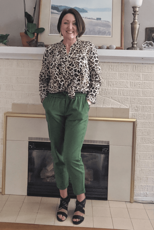 Leopard print blouse with green linen joggers make a fun date night outfit.