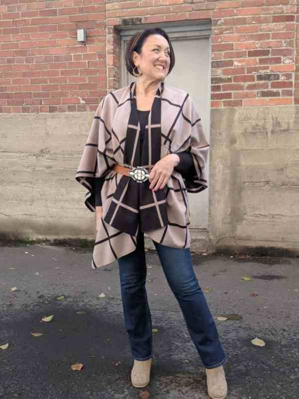 Belted cape shawl with a pair of boot cut jeans.