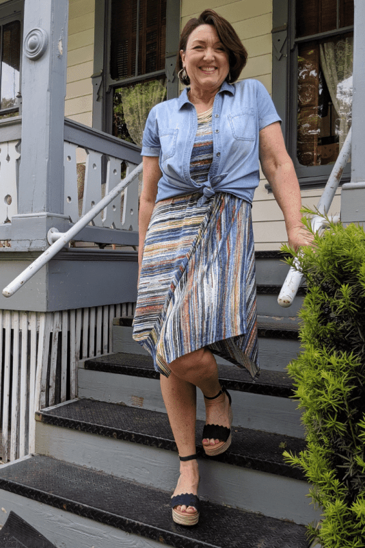 Cover your arms with a button up chambray shirt over a knit sleeveless dress.