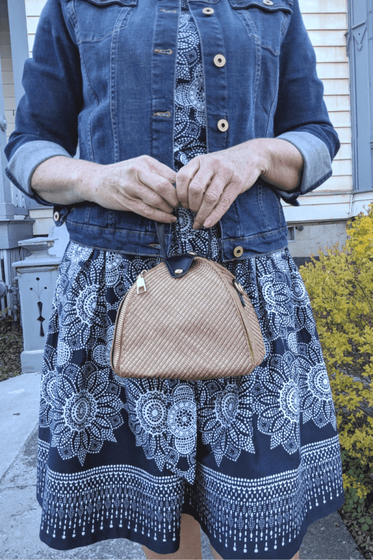 A triangle shaped straw purse for summer is just the right size to hold your essentials.  The natural straw color goes great with a blue jean jacket outfit.