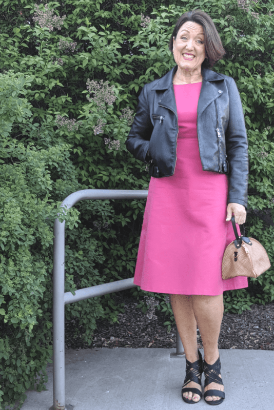 Add a black leather moto jacket to a fit and flare dress for a date night look!
