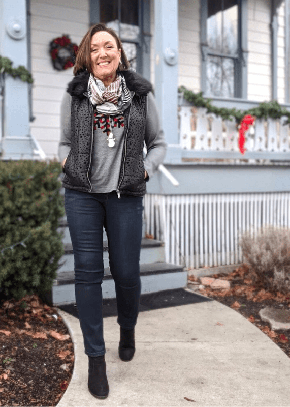 Weekend holiday outfit with fun faux fur collar vest and snowman necklace,