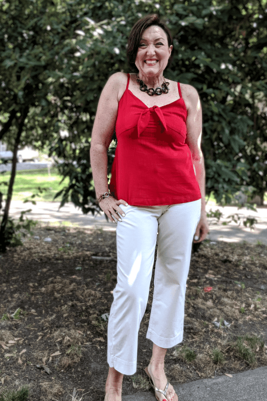 Bright red Tie Front Cami and Wide Leg cream Chinos