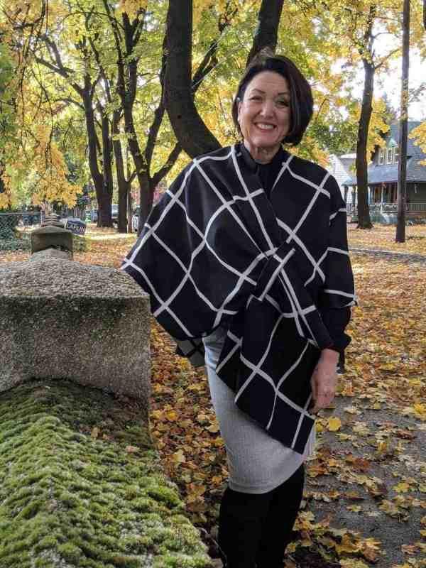 An asymmetrical cut shawl with a knit pencil skirt for Fall.