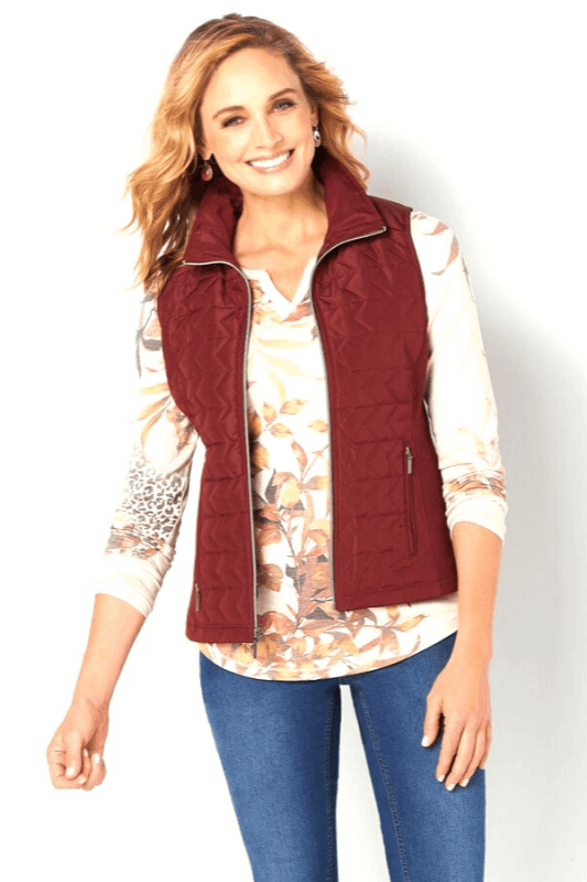 A classic go-to, this Quilted Vest is designed with a mock-neck collar for extra warmth and zip pockets for any must-haves.