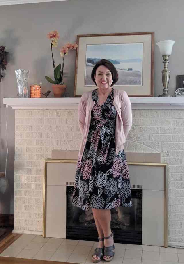 thrift shop floral dress from Garnett Hill with soft pink cardigan