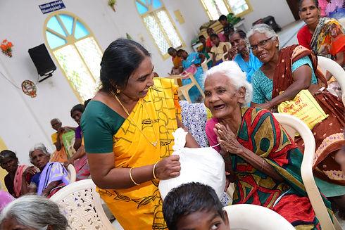 prema aunty embracing elders.JPG