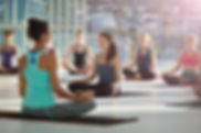 large-group-meditating-at-yoga-practice-