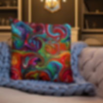 a colorful pillow with a swirl design on a couch