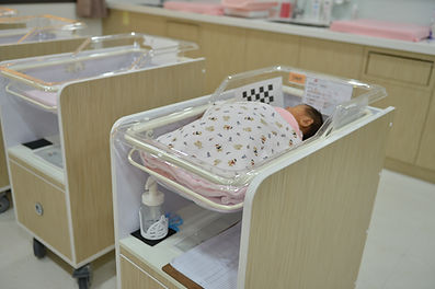 桃園中壢-滿悅專業坐月子中心-滿悅產後護理之家-嬰兒床.jpg