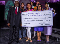Bishop & 1st Lady Giving to Operation Ho