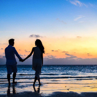 man-and-woman-holding-hands-walking-on-s